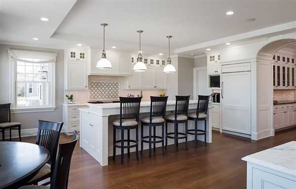 Luxury properties warm residence with sweeping water views