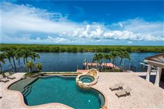 Mansions in unobstructed sunset views and sail boat access to the Gulf of Mexico