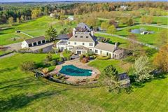 Mansions in an exquisite and unique property on lush 17-acres that includes its own pond