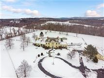an exquisite and unique property on lush 17-acres that includes its own pond luxury homes
