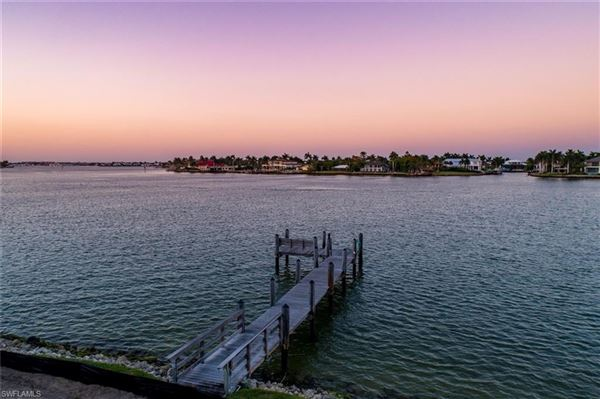 Luxury real estate new coastal traditional on Naples Bay