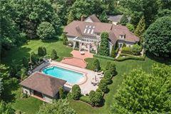 Stunning year-round retreat beautifully sited luxury real estate