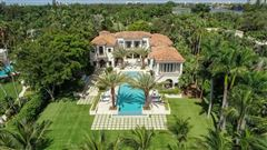 Waterfront mansion sits on a lush 1.2-acre lot luxury homes
