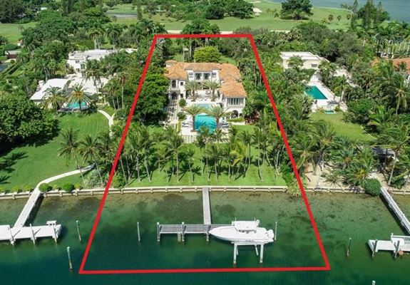 Luxury homes Waterfront mansion sits on a lush 1.2-acre lot