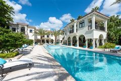 Waterfront mansion sits on a lush 1.2-acre lot luxury real estate