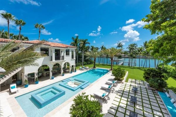 Luxury real estate Waterfront mansion sits on a lush 1.2-acre lot