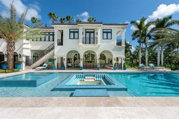 Luxury properties Waterfront mansion sits on a lush 1.2-acre lot