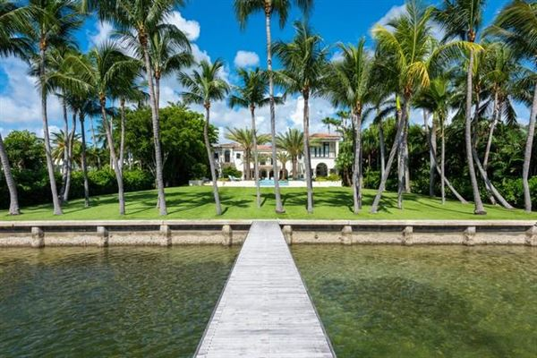 Waterfront mansion sits on a lush 1.2-acre lot mansions