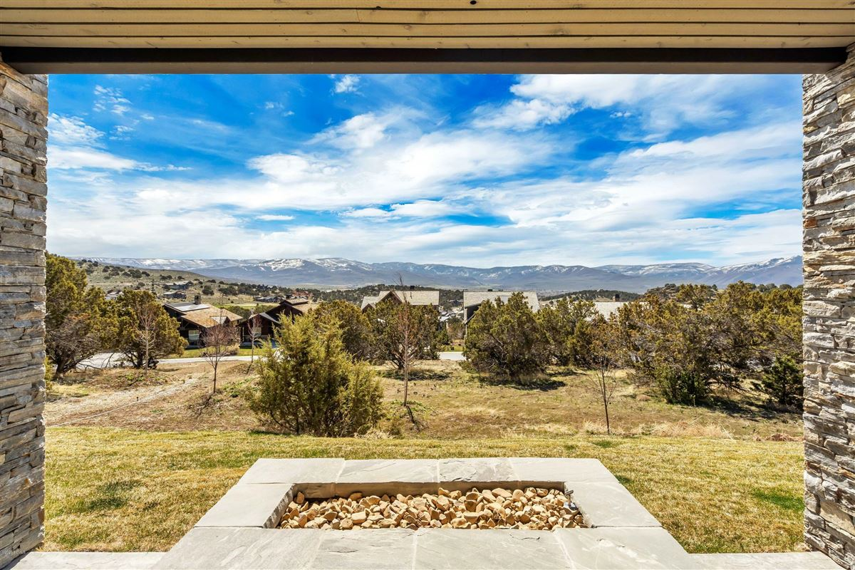 Luxury real estate Luxurious executive home located in the golf/tennis community of Red Ledges.