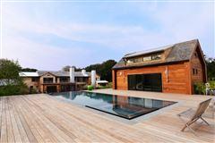 A modern barn residence in sagaponack luxury properties