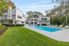 Luxury real estate pristine Post Modern home situated in a lovely cul-de-sac