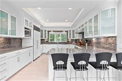 pristine Post Modern home situated in a lovely cul-de-sac mansions