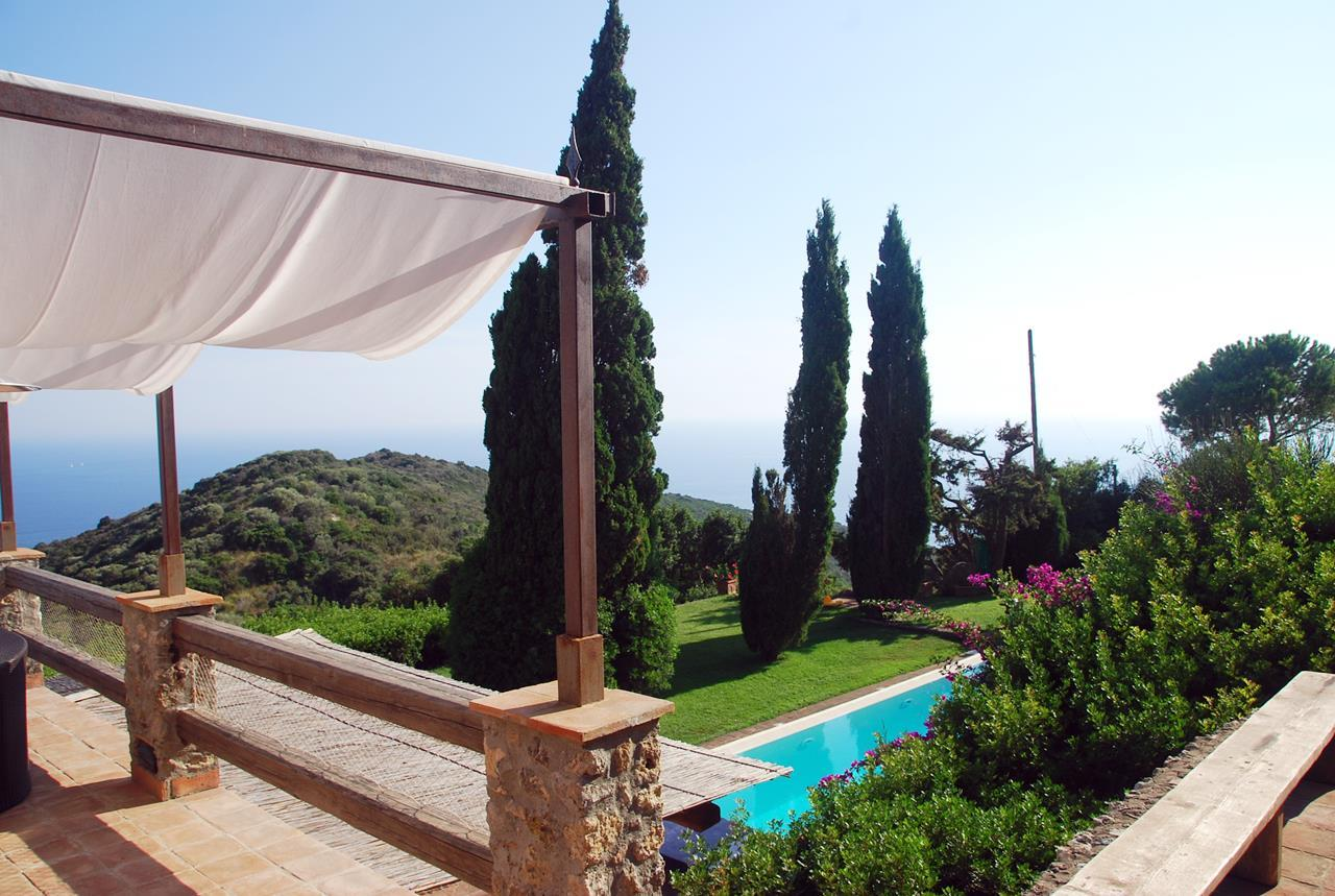 Villa with broad garden and pool overlooking the sea in Argentario luxury real estate