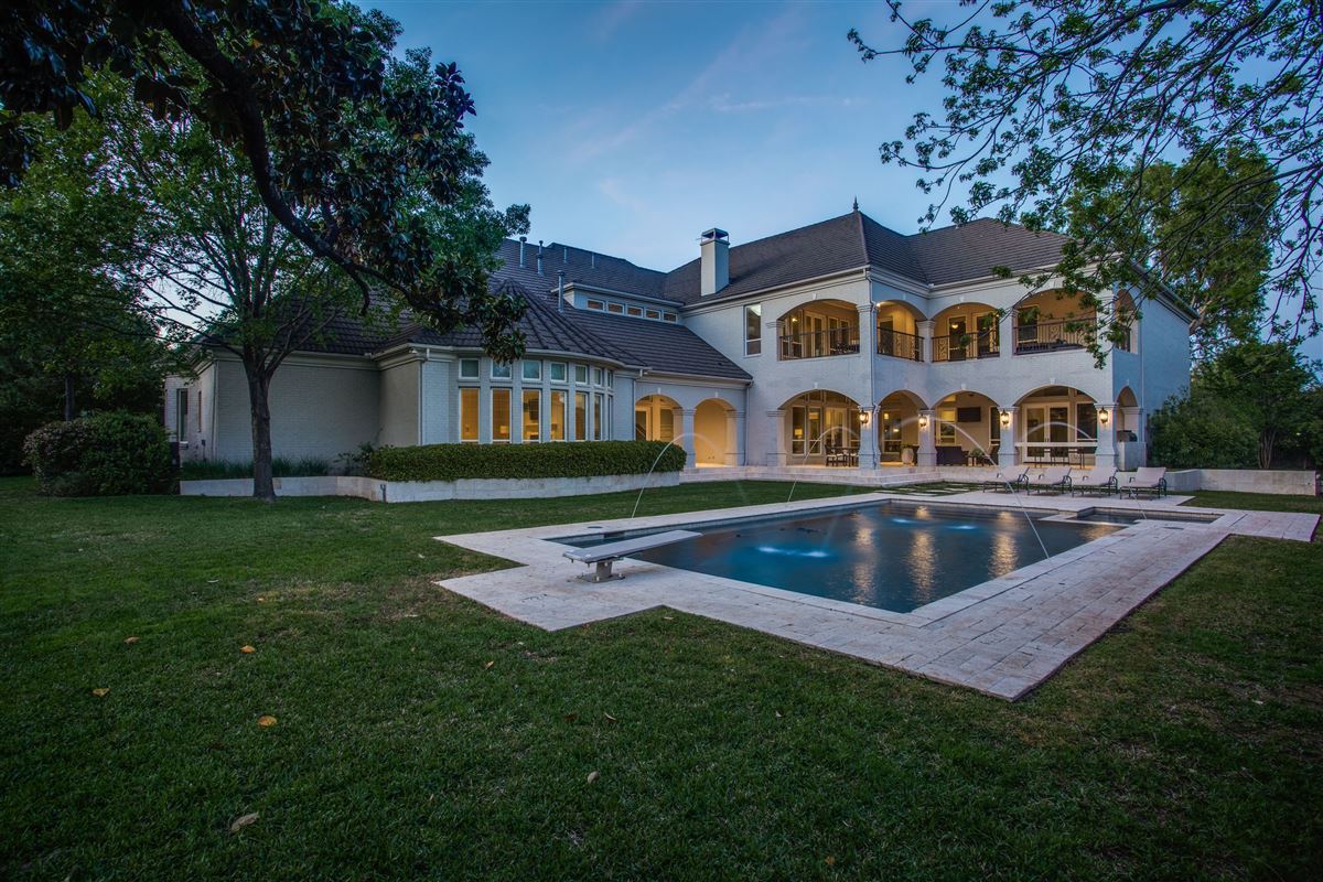 Gated Preston Hollow estate with casual elegance luxury homes