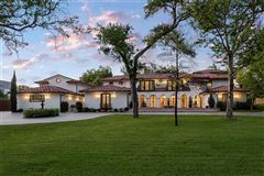 Expanded and remodeled spanish style home luxury homes