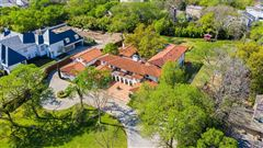 Luxury properties Expanded and remodeled spanish style home