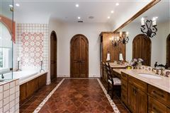 Expanded and remodeled spanish style home luxury properties