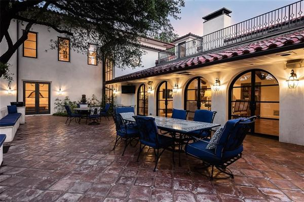 Expanded and remodeled spanish style home mansions