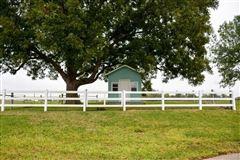 elegant farmhouse with gracious wrap-around porch luxury properties