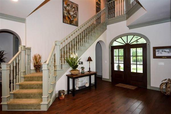 elegant farmhouse with gracious wrap-around porch luxury homes