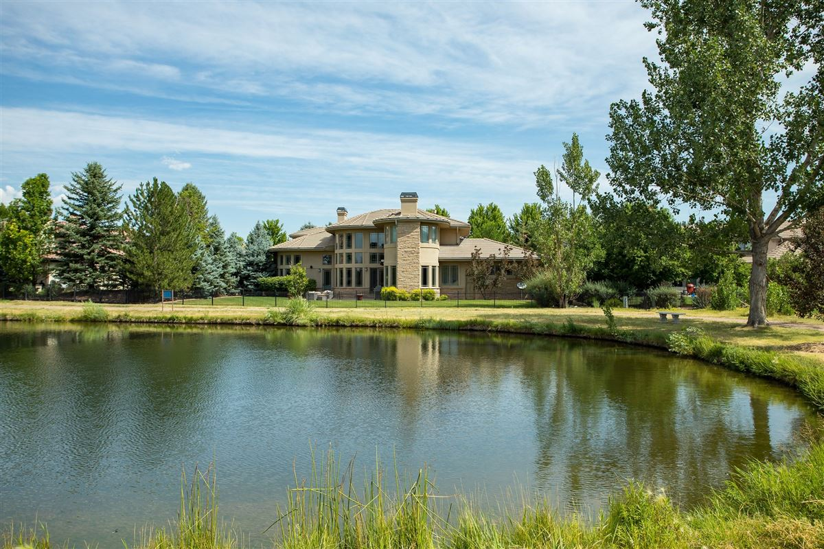 Luxury homes in stylishly updated home overlooking Buell Lake