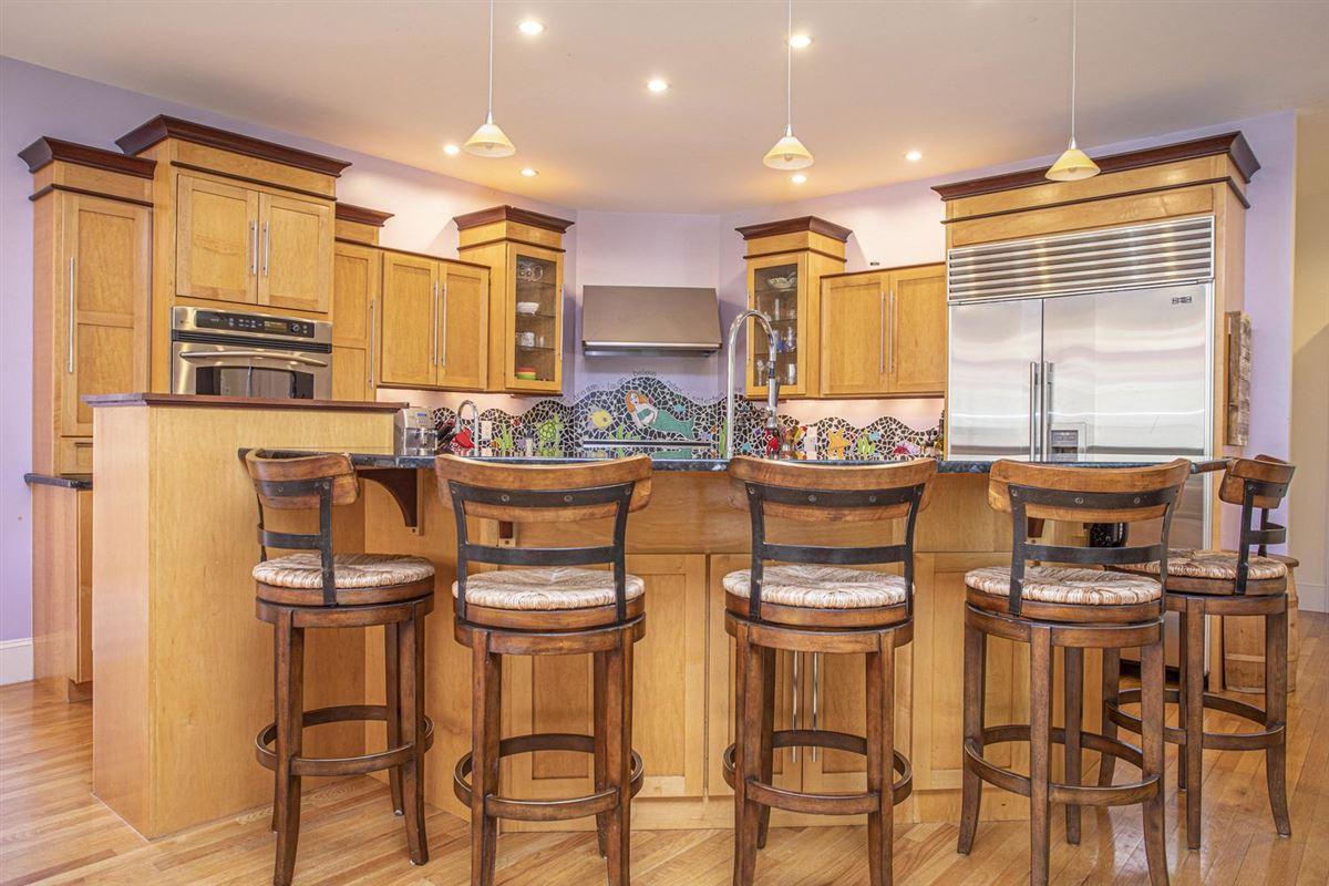 Luxury properties custom built Contemporary home at The Ridge Club
