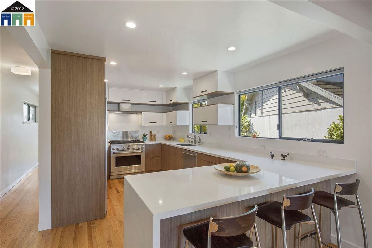 Luxury homes in extensively updated mid-century lagoon home