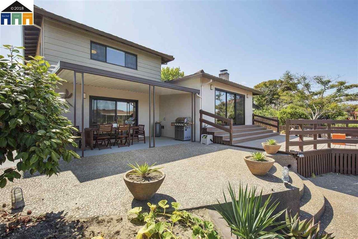 Luxury properties extensively updated mid-century lagoon home