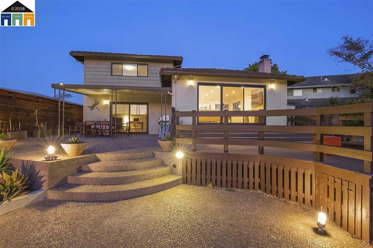 Mansions extensively updated mid-century lagoon home