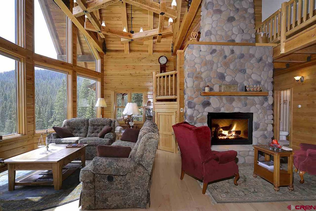 Luxury homes Three-story Oak Log Sided Home Boasts Grand Views