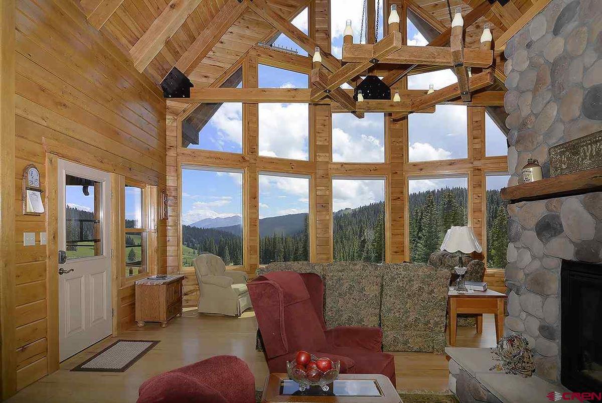 Three-story Oak Log Sided Home Boasts Grand Views  luxury homes