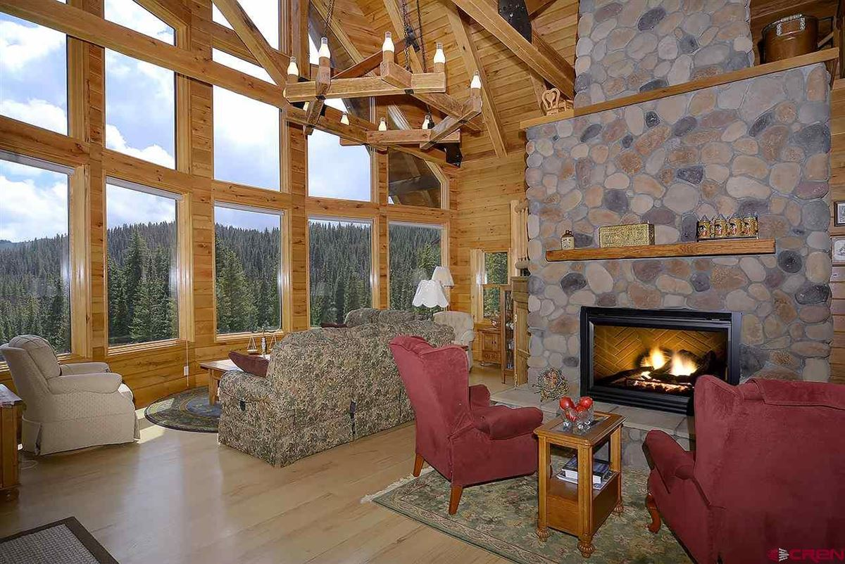 Three-story Oak Log Sided Home Boasts Grand Views  luxury real estate