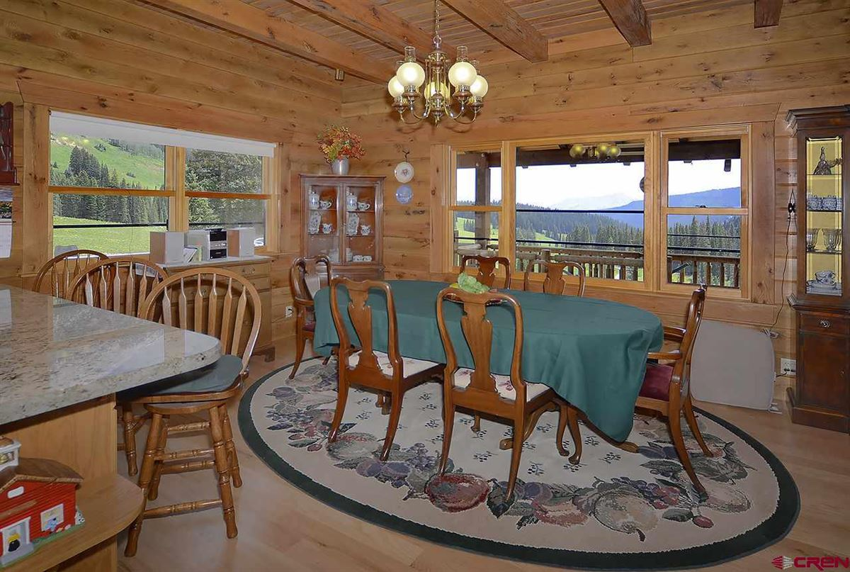 Three-story Oak Log Sided Home Boasts Grand Views  luxury properties