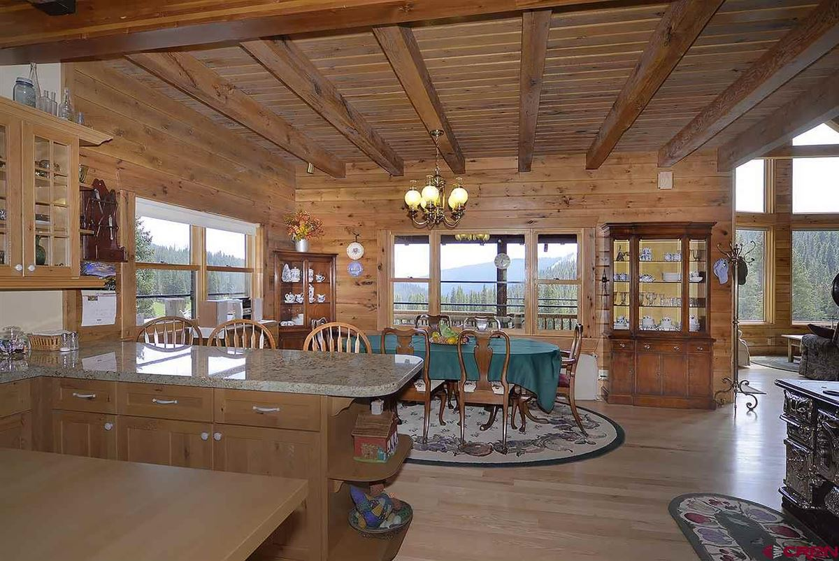 Three-story Oak Log Sided Home Boasts Grand Views  mansions