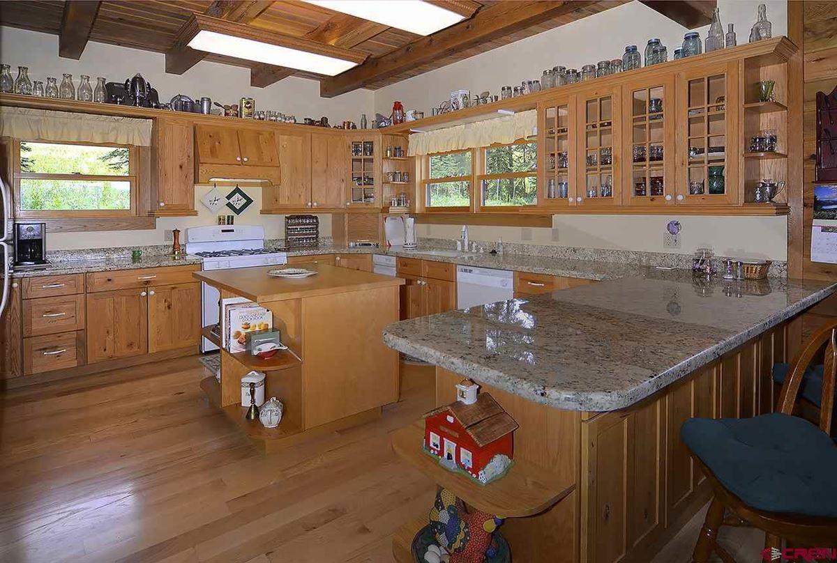Luxury homes in Three-story Oak Log Sided Home Boasts Grand Views