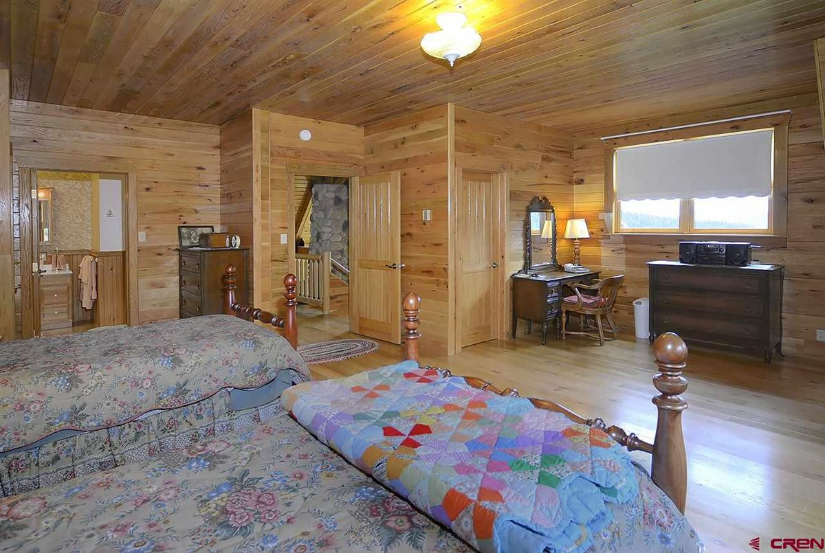 Luxury real estate Three-story Oak Log Sided Home Boasts Grand Views