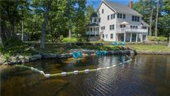 Luxury properties gracefully poised on Quidnick Reservoir