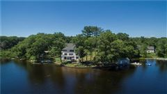 gracefully poised on Quidnick Reservoir  luxury properties