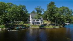 Luxury homes gracefully poised on Quidnick Reservoir