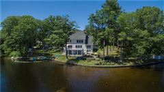 gracefully poised on Quidnick Reservoir  luxury homes