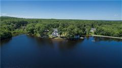 Luxury real estate gracefully poised on Quidnick Reservoir