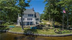 gracefully poised on Quidnick Reservoir  luxury real estate