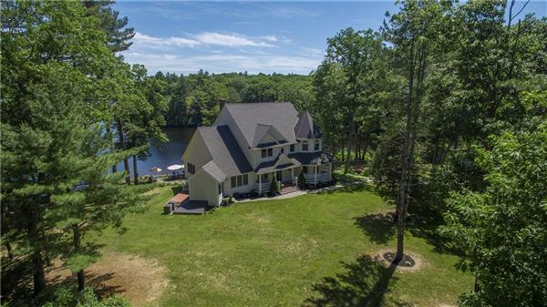 Mansions gracefully poised on Quidnick Reservoir