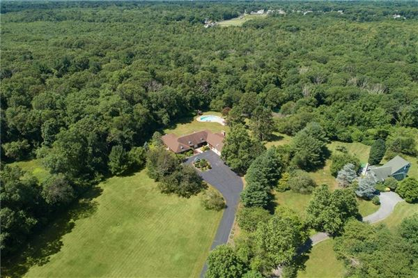 Luxury real estate custom-built contemporary ranch on over 26 acres