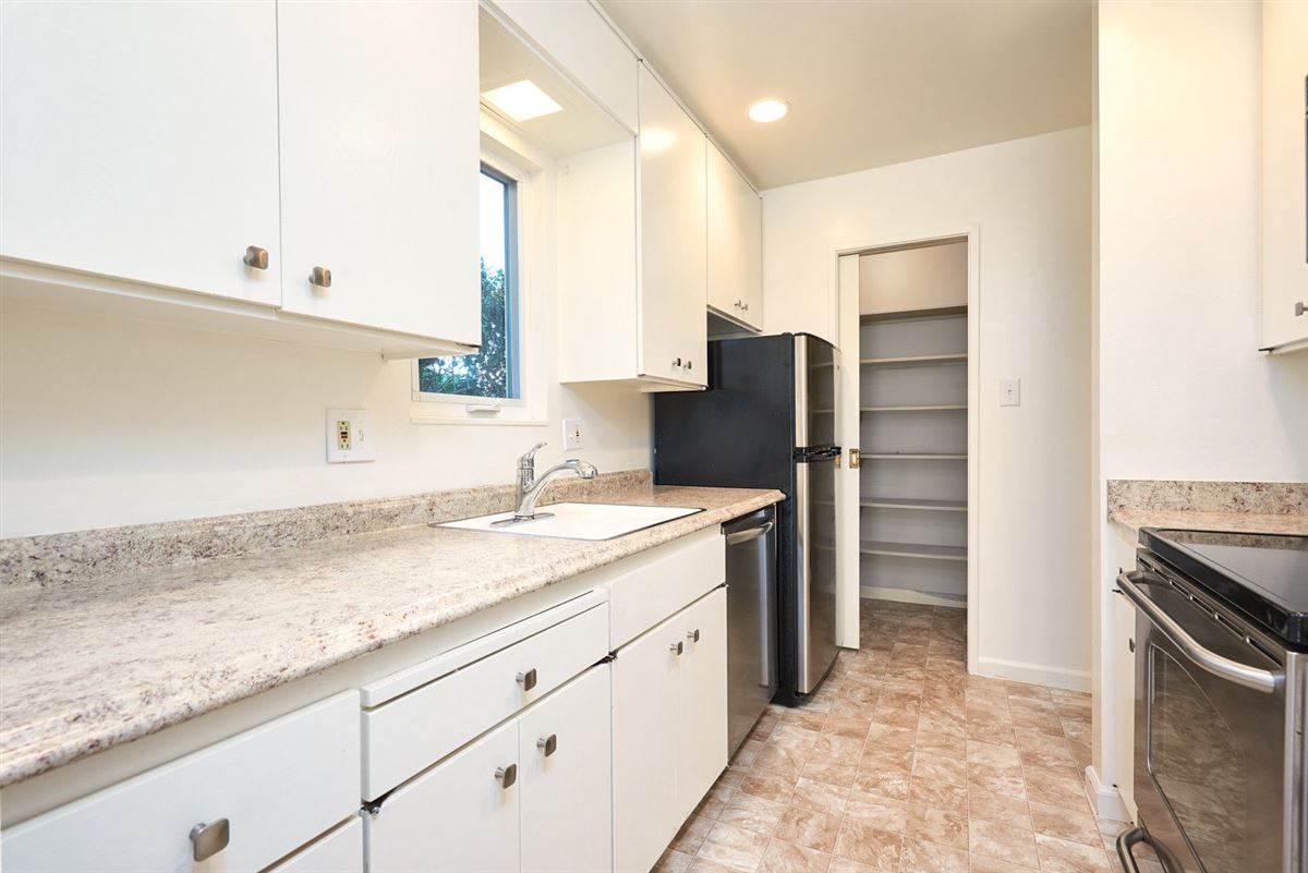 Luxury properties This beautifully remodeled Townhome is strategically located