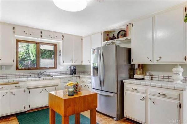 Mansions in this single level charmer is full of personality and good vibes