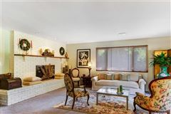 Luxury homes in this single level charmer is full of personality and good vibes