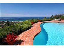 Luxury homes in enjoy 180 degree sit down ocean cove views