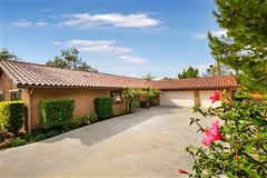 Picture perfect single level home with incredible outdoor entertaining area mansions
