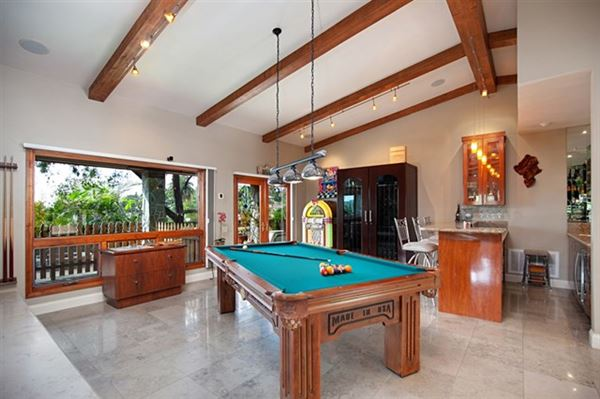Luxury properties Picture perfect single level home with incredible outdoor entertaining area